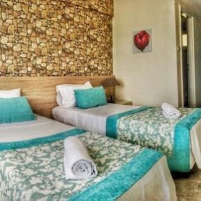 Hostales y Albergues - Sunset Garden Hotel