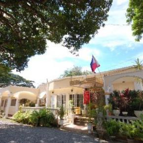 Hostales y Albergues - D' Lucky Garden Inn and Suites Palawan